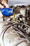 Hand pouring motor oil in car engine Stock Photo - Premium Royalty-Free, Artist: Robert Harding Images, Code: 698-06116621