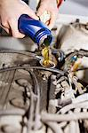 Man's hand pouring motor oil in car engine Stock Photo - Premium Royalty-Free, Artist: Universal Images Group, Code: 698-06116622