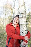 Portrait of woman hugging tree in forest Stock Photo - Premium Royalty-Free, Artist: CulturaRM, Code: 698-06116651
