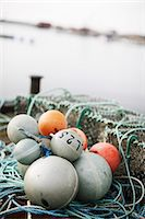 Close-up of fishing equipment buoy Stock Photo - Premium Royalty-Freenull, Code: 698-06116868