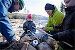 Men cooking while children looking at camping site Stock Photo - Premium Royalty-Freenull, Code: 698-06117006