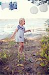 Girl dancing in the backyard of a house Stock Photo - Premium Royalty-Free, Artist: Raymond Forbes, Code: 698-06117068