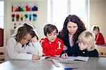 Teacher and students in the classroom Stock Photo - Premium Royalty-Free, Artist: Bettina Salomon, Code: 698-06117257