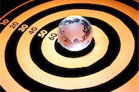 Close-up of dart board with globe on it Stock Photo - Premium Royalty-Freenull, Code: 6107-06117433