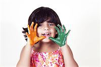 Portrait of a young girl with colored palms Stock Photo - Premium Royalty-Freenull, Code: 6107-06117573