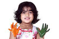 Portrait of a young girl with colored palms Stock Photo - Premium Royalty-Freenull, Code: 6107-06117574