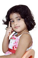 Portrait of a young girl posing Stock Photo - Premium Royalty-Freenull, Code: 6107-06117578