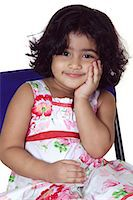 Close-up of a young girl smiling Stock Photo - Premium Royalty-Freenull, Code: 6107-06117579