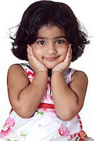 Close-up of a young girl smiling Stock Photo - Premium Royalty-Freenull, Code: 6107-06117580