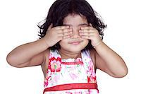 Portrait of a young girl covering her eyes with her hands Stock Photo - Premium Royalty-Freenull, Code: 6107-06117581