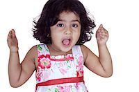 Portrait of a girl looking curiously Stock Photo - Premium Royalty-Freenull, Code: 6107-06117582