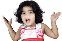 Portrait of a girl looking curiously Stock Photo - Premium Royalty-Freenull, Code: 6107-06117583