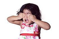 Portrait of a young girl covering her eyes with her hands Stock Photo - Premium Royalty-Freenull, Code: 6107-06117584