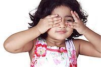Portrait of a young girl covering her eyes with her hands Stock Photo - Premium Royalty-Freenull, Code: 6107-06117585