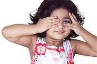 Portrait of a young girl covering her eyes with her hands Stock Photo - Premium Royalty-Freenull, Code: 6107-06117586