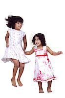 Portrait of young girls jumping Stock Photo - Premium Royalty-Freenull, Code: 6107-06117587