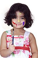 Portrait of a girl with paint brush Stock Photo - Premium Royalty-Freenull, Code: 6107-06117588
