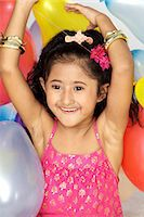Girl Playing with balloons Stock Photo - Premium Royalty-Freenull, Code: 6107-06117854