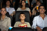 Family watching movie in theater Stock Photo - Premium Royalty-Freenull, Code: 632-06118433