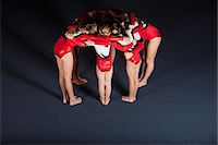 preteen girls gymnastics - Team of gymnasts huddling Stock Photo - Premium Royalty-Freenull, Code: 632-06118501