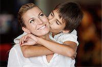 preteen kissing - Boy kissing his mother's cheek Stock Photo - Premium Royalty-Freenull, Code: 632-06118540