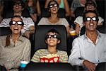 Family watching 3-D movie in theater Stock Photo - Premium Royalty-Free, Artist: F. Lukasseck, Code: 632-06118660