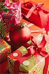 Christmas ornament resting on festively wrapped gifts Stock Photo - Premium Royalty-Free, Artist: Susan Findlay, Code: 632-06118747