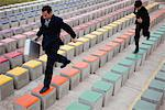 Business executives racing on bleachers Stock Photo - Premium Royalty-Free, Artist: Cultura RM, Code: 632-06118879