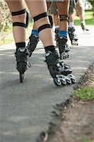 roller skate - People inline skating in a row, low section Stock Photo - Premium Royalty-Freenull, Code: 632-06118901