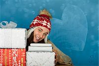 Young woman with stacks of Christmas gifts, portrait Stock Photo - Premium Royalty-Freenull, Code: 632-06118906