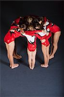 preteen girls gymnastics - Team of gymnasts huddling Stock Photo - Premium Royalty-Freenull, Code: 632-06118953