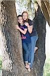 Two Teenage Girls Hugging in Tree Stock Photo - Premium Rights-Managed, Artist: Kevin Dodge, Code: 700-06119527