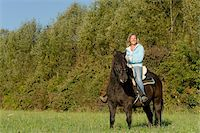 Portrait of Woman Riding Pony Stock Photo - Premium Rights-Managednull, Code: 700-06119561