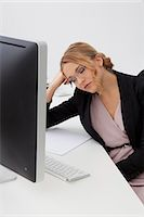 people in panic - Young woman with closed eyes at desk Stock Photo - Premium Rights-Managednull, Code: 853-06120590