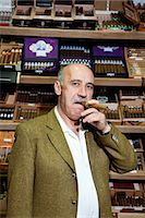 Portrait of a mature man smoking cigar in tobacco store Stock Photo - Premium Royalty-Freenull, Code: 693-06120798