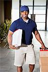 African American man carrying boxes for delivery Stock Photo - Premium Royalty-Freenull, Code: 693-06120813