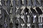 Keys hanging on hooks in store Stock Photo - Premium Royalty-Free, Artist: Ikon Images, Code: 693-06120834