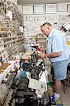 Side view of senior locksmith working in store Stock Photo - Premium Royalty-Free, Artist: Cultura RM, Code: 693-06120840