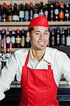 Portrait of a happy bartender in bar Stock Photo - Premium Royalty-Free, Artist: R. Ian Lloyd, Code: 693-06120846