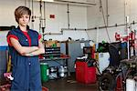 Portrait of a confident young female mechanic with arms crossed in garage Stock Photo - Premium Royalty-Free, Artist: Cusp and Flirt, Code: 693-06120952
