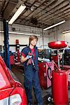 Portrait of a young mechanic standing by welding equipment Stock Photo - Premium Royalty-Free, Artist: Aurora Photos, Code: 693-06120955
