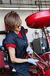 Young female mechanic working on welding equipment Stock Photo - Premium Royalty-Free, Artist: Blend Images, Code: 693-06120957