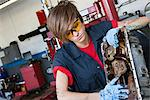 Young female mechanic working on automobile machinery part in workshop Stock Photo - Premium Royalty-Free, Artist: Cusp and Flirt, Code: 693-06120961