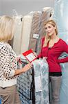 Young woman holding price list while looking at mother in furniture store Stock Photo - Premium Royalty-Free, Artist: Cultura RM, Code: 693-06121038