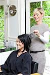 Cheerful hairstylist looking at hair of beautiful woman in beauty salon Stock Photo - Premium Royalty-Free, Artist: Cultura RM, Code: 693-06121098
