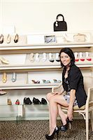 Mid adult female customer trying on heels in shoe store Stock Photo - Premium Royalty-Freenull, Code: 693-06121134