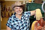 Portrait of a happy mature cowboy in feed store Stock Photo - Premium Royalty-Free, Artist: Robert Harding Images, Code: 693-06121158