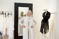 Portrait of a happy senior woman trying on clothes in fashion boutique Stock Photo - Premium Royalty-Freenull, Code: 693-06121214