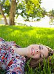 Woman Lying on Grass, Miami Beach, Florida, USA Stock Photo - Premium Royalty-Free, Artist: Raoul Minsart, Code: 600-06125458