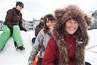 Teenagers Tobogganing, Mount Washington Ski Resort, Vancouver Island, British Columbia, Canada Stock Photo - Premium Rights-Managednull, Code: 700-06125571